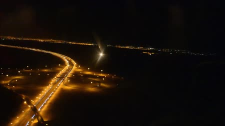 air vehicle : Beautiful aerial flight view from passenger air plane wing on bright night big city light illumination in dark black sky Stock Footage