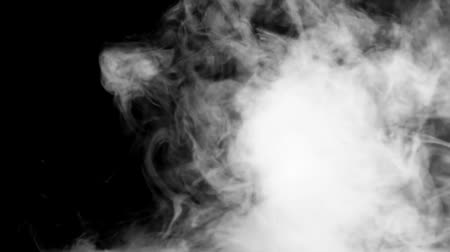 noc : Incredible close up slow motion view on white smoke steam cloud fog on dark black background Wideo