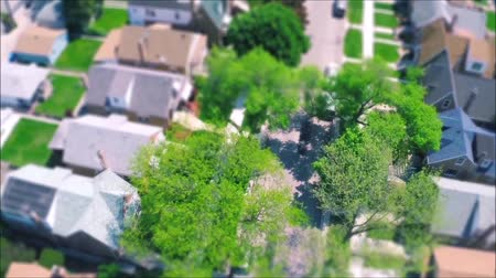 residencial : Fascinating drone panorama aerial tilt shift view on tiny houses villas in suburb town village neighborhood