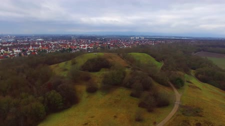 torre : Amazing aerial 4k drone flight over calm small city cityscape with big mirror surface lake in park on cloudy day