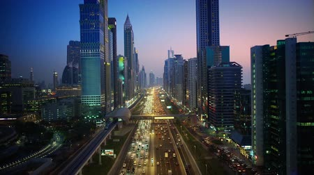 高層 : Magnificent downtown Dubai modern architecture highway in pink evening sunset night illumination on 4k aerial ciytscape