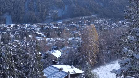 hegyoldalban : Incredible aerial drone view on small luxury resort village cozy villas in pine tree winter forest in Alps mountains