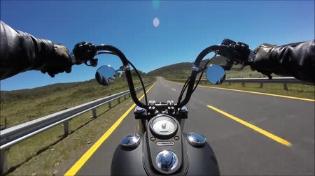 крейсер : First person pov view on professional biker riding fast downhill highway road on black motor bike in gorgeous landscape