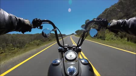 motor vehicle : First person pov shot of professional biker riding fast downhill highway road on black motor bike in amazing landscape Stock Footage
