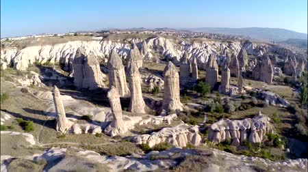 globos : Impressive aerial panorama view on huge sand stone rock canyon desert in mountain chain hill landscape Archivo de Video