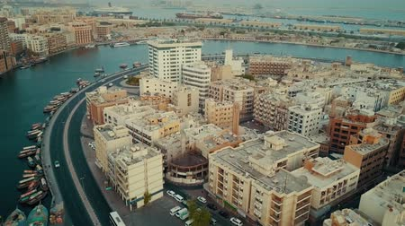 residencial : Fascinating 4k aerial drone panorama flyover in Dubai Emirate modern architecture of big harbor city near ocean water