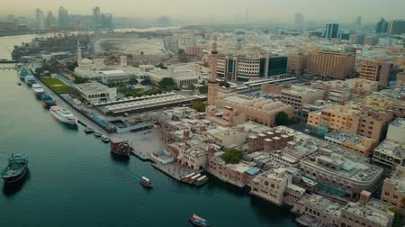 residencial : Magnificent 4k aerial drone panorama flyover in Dubai Emirate downtown modern architecture of big ocean harbor city