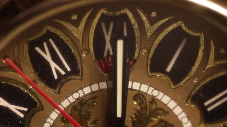 Old clock close up. Time has stopped at 12 oclock exactly. Стоковые видеозаписи