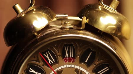Old golden clock is ticking closeup. Стоковые видеозаписи