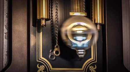 The pendulum of the old clock with the battle close up. Стоковые видеозаписи