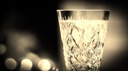 Glass of champagne close-up in sepia color. Стоковые видеозаписи