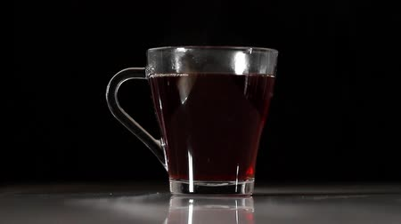 brew tea : Tea is poured into a glass.