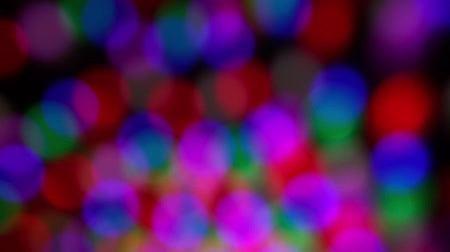 Colorful blurred abstraction of a disco luminous ball.
