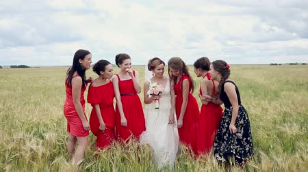 Emotional bride and bridesmaids talking and laughing. Slow motion.