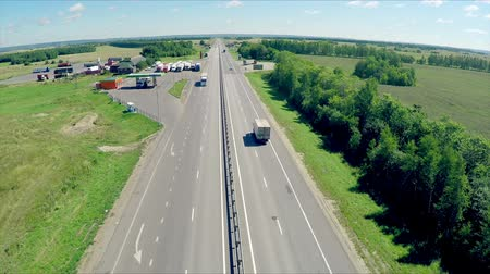 trucks : Aerial view of a highway with cars driving along a road. The gas station, hotel and road service. Stock Footage