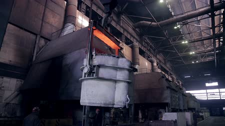 open hearth : Smelting of liquid metal in tank, container, reservoir at the metallurgical plant. Stock Footage