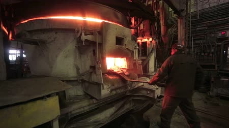 open hearth : Worker operates in blast furnace workshop at the metallurgical plant.