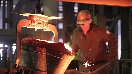 metal worker : Worker on steel plant operates with  molten metal.