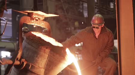 open hearth : Workers on steel plant operates with molten metal. Stock Footage