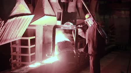 brickwall : Iron and Steel Works. Pouring of molten iron.