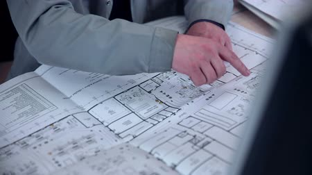 planos : Architect works  with blueprint.