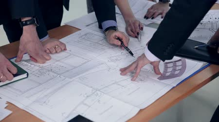 blueprint : Group engineers and architects discuss the blueprint. Stock Footage