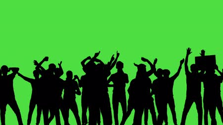 siluety : A crowd of dancing people, all in silhouette, on a greenscreen.