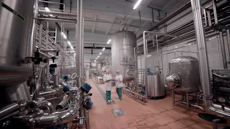 pharmaceuticals : Unrecognizable Researcher team working in pharmaceutical factory.