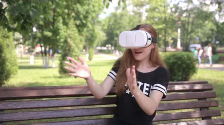 simülasyon : Young woman using VR helmet with head mount display. Outdoors.