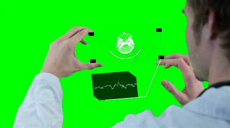 tudományos : Scientist, doctor using futuristic touchscreen technology, showing x-ray. Motion graphic on chromakey.