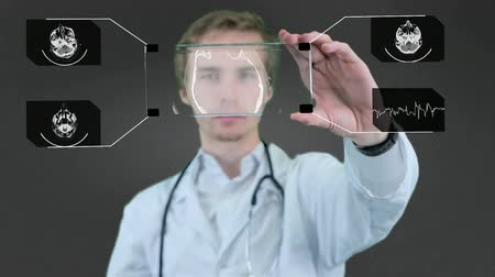przyszłość : Professional scientist, doctor using futuristic touchscreen technology, showing x-ray. Motion graphic.