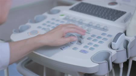 equipamento : Ultrasound edevice keyboard closeup, hands of doctor clicks on the button. HD.