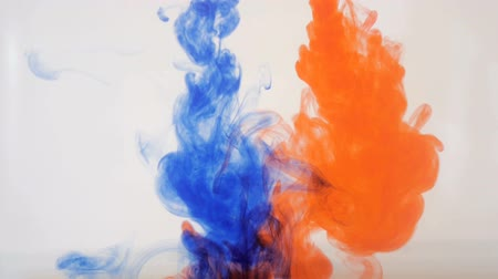 coloured background : Colourfull background. Blue and red ink dropped in water. Slow motion.