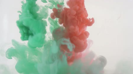 coloured background : Colourfull background. Red and green inks dropped in water. Slow motion. Stock Footage