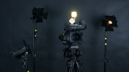 videocamera : Professional digital video camera, camcoder isolated on black background in tv srudio.