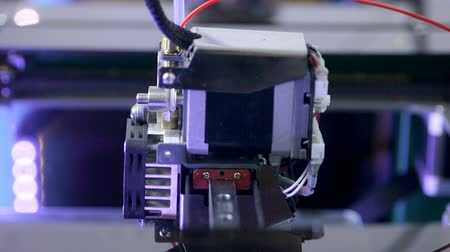 eject : Close up. 3D printer making part of human prosthesis. Stock Footage