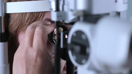 astigmatism : Female patient on medical attendance at the optometrist. Contemporary modern medical equipment. Stock Footage