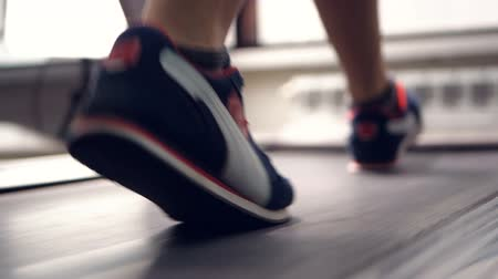 buty sportowe : Female legs walking and running on treadmill in gym. Healthy lifestyle concept. Slow motion. Wideo