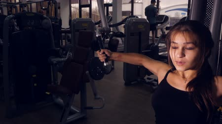 ethic : Beautiful asian ethic sporty female doing sports exercise workout in a gym.