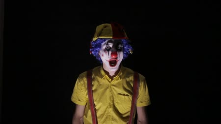 grotesque : Scary shot of a spooky clown.