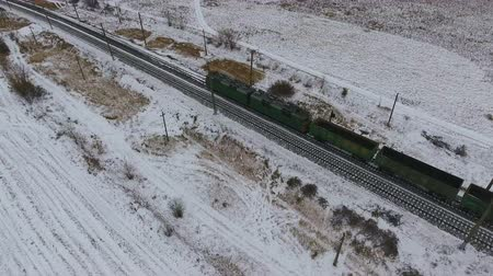 vasúti : Aerial view of cargo train delivering goods, fuel, petrolium in winter.