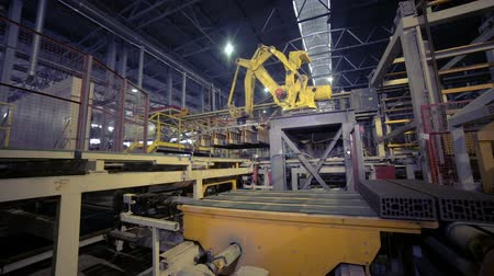 botok : Industrial robot. Robotic arm assembling products on a modern plant.