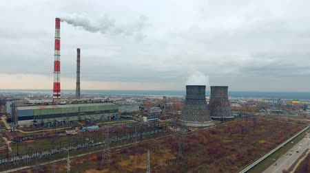 polar circle : Smoking chimneys, pipe at a thermal power plant. Aerial view made from copter, drone.
