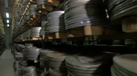 raflar : Film Archive. Films, movie reels on a shelfs in a huge old movie archive.
