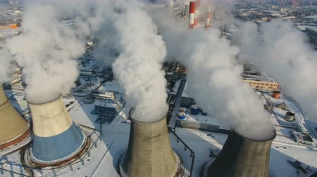 дымоход : Smoke and steam from industrial power plant. Contamination, pollution, global warming concept. Aerial. Стоковые видеозаписи