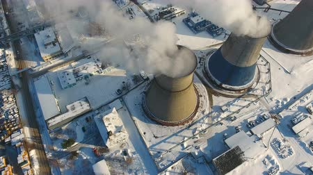 from air : Smoke and steam from chimneys at a thermal power station. Drone shot. Stock Footage
