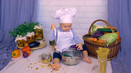 kiddy : Cute baby child cooking healthy food from vegetables. Stock Footage