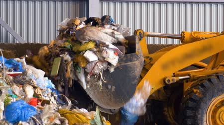 guba : Bulldozer, tractor pushes a pile of trash at landfill. Stock mozgókép