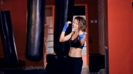 sassy : Provocative female Fighter teases, calls for the fight.