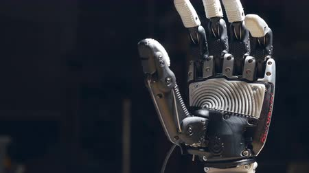 рука : Close up of the robot hands closing.